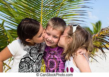 Happy children enjoy summer day at the beach