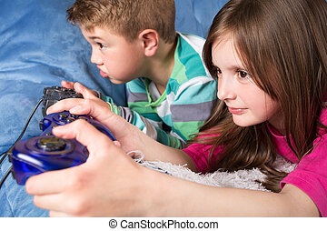 girl and boy playing a video game