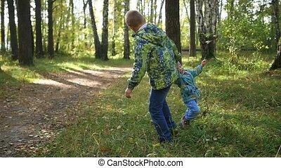 children have fun playing in autumn Park