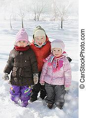 Happy children having fun in winter
