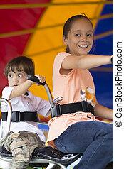Happy children having fun riding