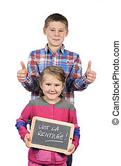 Happy children holding a slate