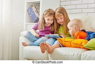 happy children holding digital tablet