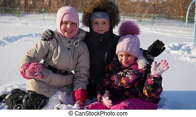 happy children hugged each other and smile in the winter park