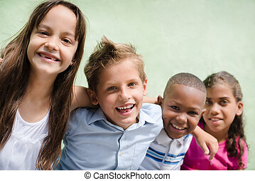 happy children hugging, smiling and having fun - Group of...
