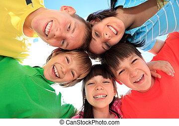 Happy children in circle