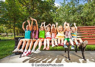 Happy children in park bench
