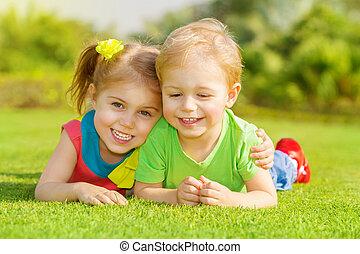 Happy children in park - Image of two happy children having...