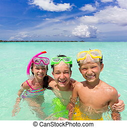 Happy children in sea
