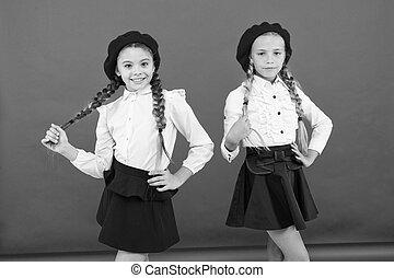 happy children in uniform. little girls in french beret....