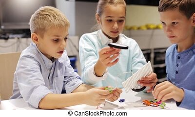 happy children learning at robotics school