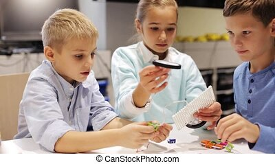 happy children learning at robotics school - education,...