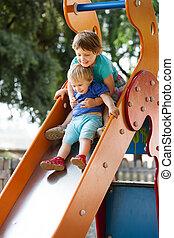 happy children on slide