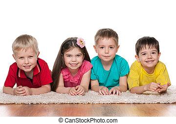 Happy children on the white carpet