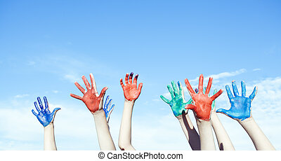 Happy children painted hands