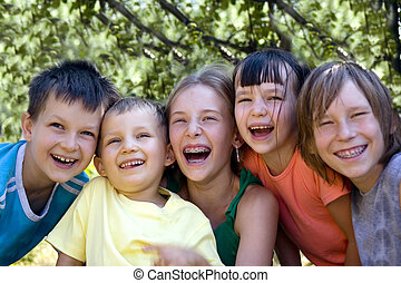 happy children - Smiling sisters and brothers in garden