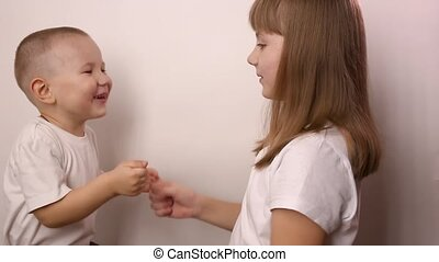 happy children play game rock paper scissor on white background, smile and laugh