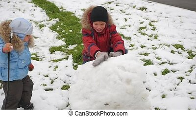 happy children play with snow in Park
