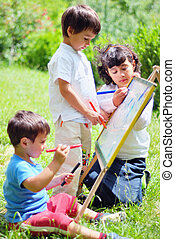 Happy children playing and drawing