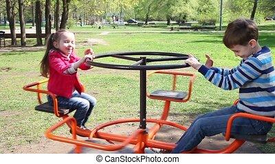 Happy children playing at playgroun