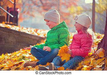 Happy children playing in autumn park