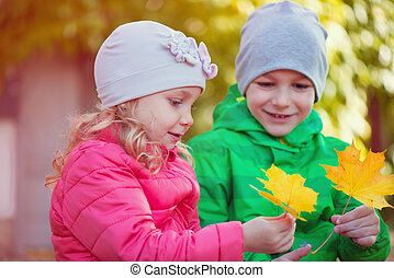 Happy children playing in autumn park