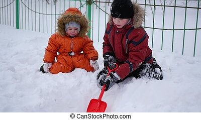 happy children playing in the Park on a Sunny winter day. Snowy winter landscape. outdoors