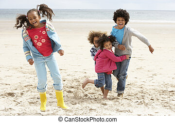 Happy children playing on beach