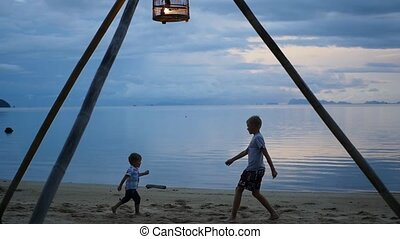 happy children playing on the seashore
