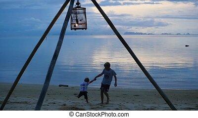 happy children playing on the seashore