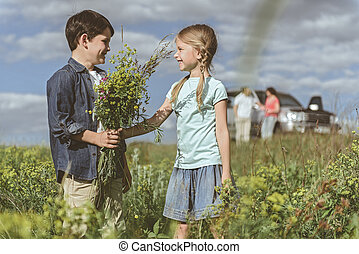 Happy children playing together on meadow