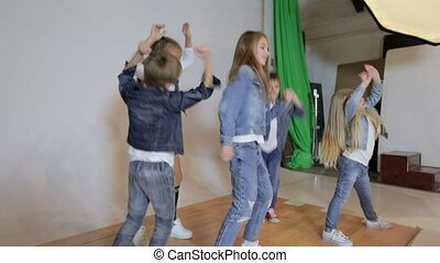 children posing, dancing and jumping in photo studio....