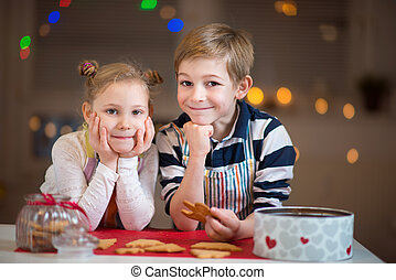 Happy children preparing cookies for Christmas and New Year