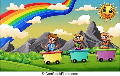 Happy children riding train on the field