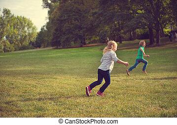 Happy children running in park