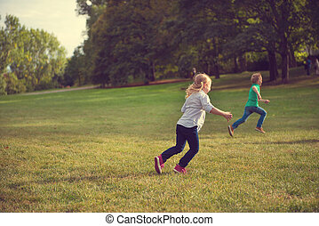 Happy children running in park