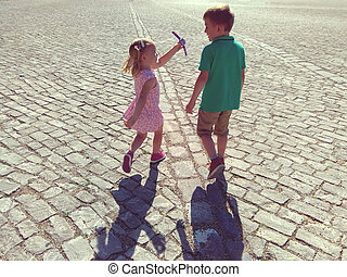 Happy children running in sunny town