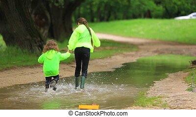 Happy Children Running Through Huge Pool In Park