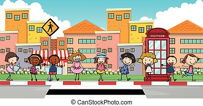 Happy children standing on sidewalk