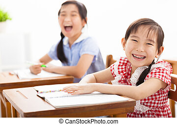 happy children study in the classroom