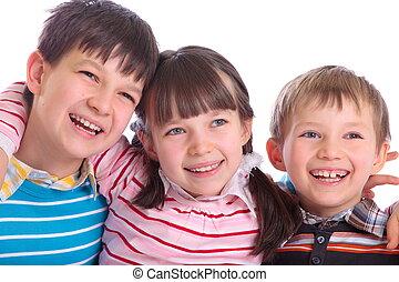 Happy children - Three happy children hugging and smiling ...