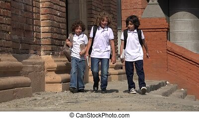 Happy Children Walking At School