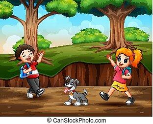Happy children walking in the forest
