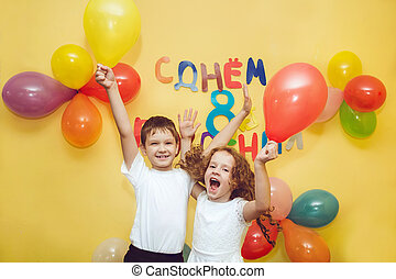 Happy children with balloons at hap