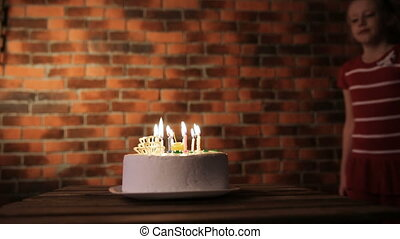 Happy children with birthday cake
