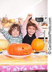 Happy children with carved pumpkins
