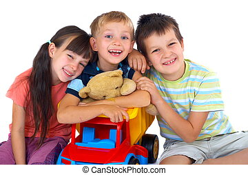 Happy children with toys - A view of three smiling, happy ...