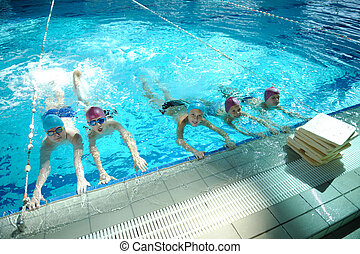 happy childrens at swimming pool - happy childrens group at...