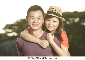 Happy Chinese couple together - Closeup Portrait of a happy...