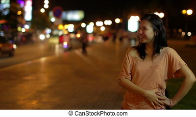 Happy chinese girl outside at night
